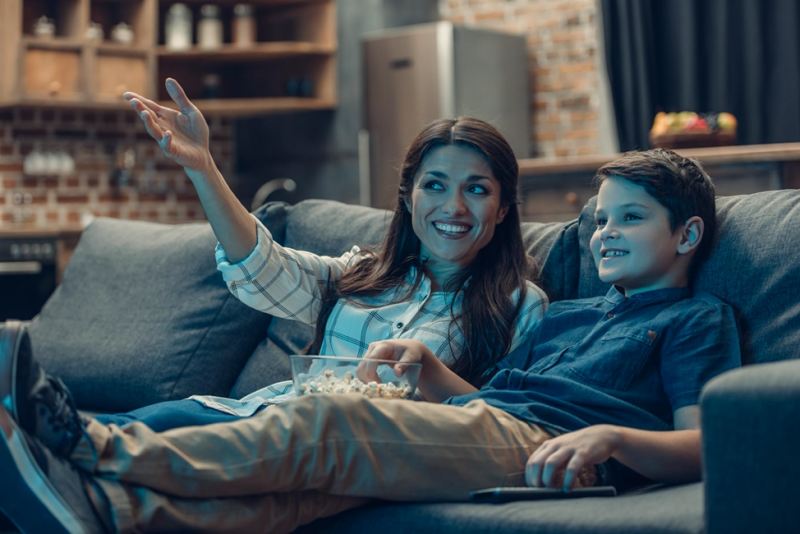 woman and child watching tv together