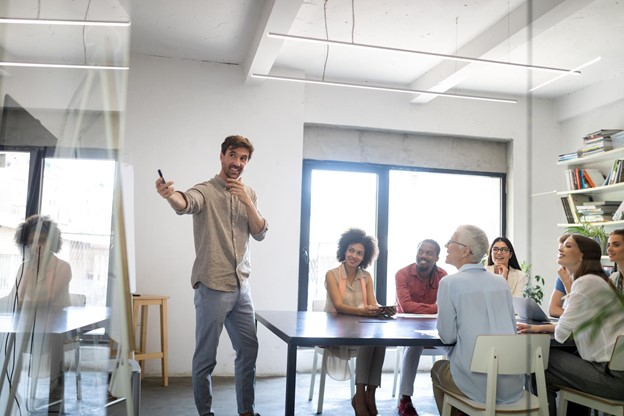Advertising team meeting reviewing TV data